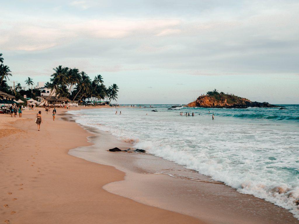 Beach and parrot rock in Mirissa, Sri Lanka