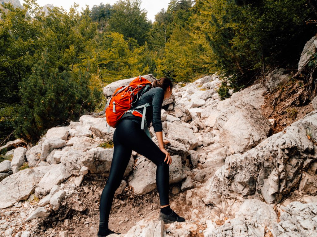 Climbing up a during the Valbona to Theth day hike